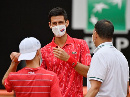Tennis - ATP Masters 1000 - Italian Open - Foro Italico, Rome, Italy - September 21, 2020  Serbia's Novak Djokovic and Argentina's Diego Schwartzman wear protective face masks before the final  Riccardo Antimiani/Pool via REUTERS