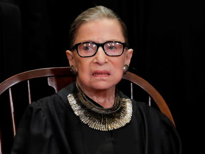 FILE PHOTO: U.S. Supreme Court Associate Justice Ruth Bader Ginsburg is seen during a group portrait session for the new full court at the Supreme Court in Washington, U.S., November 30, 2018. REUTERS/Jim Young/File Photo