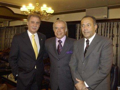 Los ex presidentes Carlos Menem y Adolfo Rodríguez Saá y el gobernador de Neuquén, Jorge Sobisch, durante una reunión del peronismo opositor al presidente Néstor Kirchner