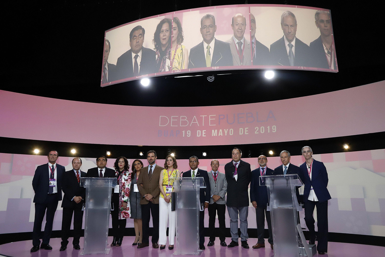 Los candidatos a la gubernatura de Puebla; Miguel Barbosa, Morena; Alberto Jiménez Merino, PRI, y Enrique Cárdenas, del PRD-PAN-MC, (Foto: CUARTOSCURO)