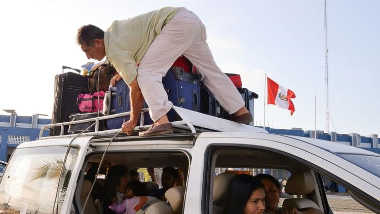 Venezolanos emigrando a Perú (AFP)