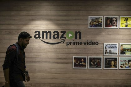 An employee walks past a wall display for Amazon.com Inc.'s Prime Video streaming service at the company's office campus in Hyderabad, India, on Friday, Sept. 6, 2019. Amazon's only company-owned campus outside the U.S. opened at the end of August on the other side of the globe, thousands of miles from their Seattle headquarters. The 15-storey building towers over the landscape in Hyderabad's technology and financial district, signaling the giant online retailer's ambitions to expand in one of the world's fastest-growing retail markets.