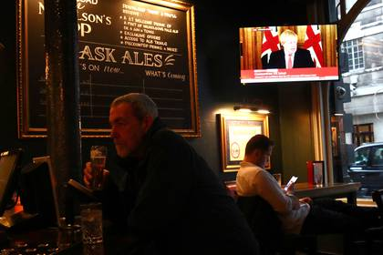 Britain's Prime Minister Boris Johnson, is seen on a television screen in a pub in London as the spread of the coronavirus disease (COVID-19) continues. In Westminster, London, Britain March 20, 2020. REUTERS/Hannah McKay