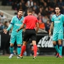 Soccer Football - La Liga Santander - Valencia v FC Barcelona - Mestalla, Valencia, Spain - January 25, 2020 Barcelona's Lionel Messi with referee Jesus Gil Manzano REUTERS/Albert Gea