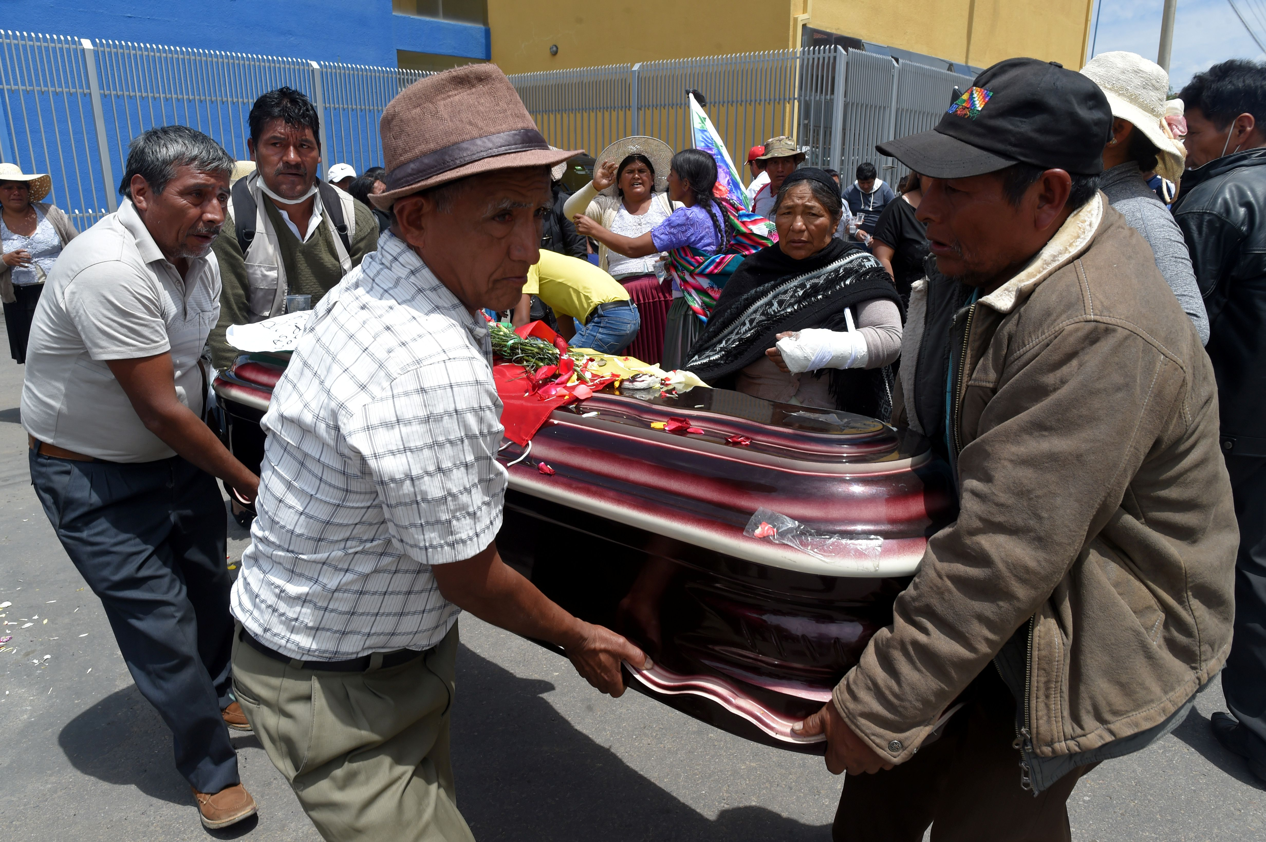 Relatives carry thye coffin of  a supporter of former Bolivia's President Evo Morales diead during clashes on Friday in Cochabamba, Bolivia, November 16, 2019. REUTERS/Danilo Balderrama