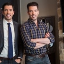 Hosts Drew (L) and Jonathan (R) Scott pose in the new living room of homeowners Katie and Justin's recently renovated Toronto home, as seen on Property Brothers.