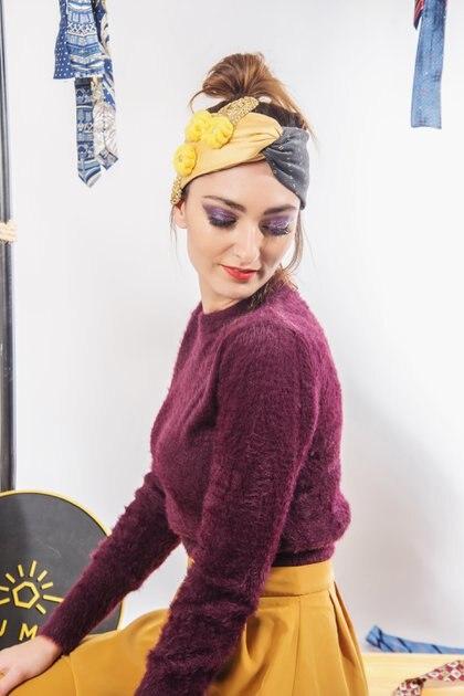 Negra y amarilla, con agregado de botones tejidos en lana (Sejmet)