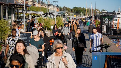 People walk on Stranvagen in Stockholm on September 19, 2020, during the novel coronavirus  COVID-19 pandemic. (Photo by Jonathan NACKSTRAND / AFP)