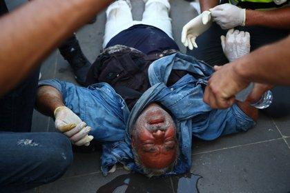 Un manifestante herido (REUTERS/Hannah McKay)
