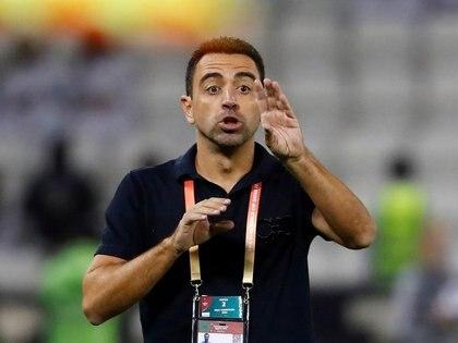 FOTO DE ARCHIVO: El entrenador de Al-Sadd Xavi reacciona durante el partido del Monterrey y Al Sadd SC, en Doha, Qatar, el 14 de diciembre de 2019 REUTERS/Kai Pfaffenbach