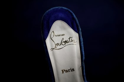 Christian Louboutin made the shoe with a red sole and its distinctive feature (Reuters)