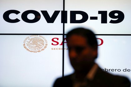 """A screen displays the term """"Covid-19"""" as Hugo Lopez-Gatell Ramirez (not pictured), Mexico's Undersecretary of Health Prevention and Promotion, holds a news conference on information about the new coronavirus, in Mexico City, Mexico February 27, 2020. REUTERS/Edgard Garrido"""