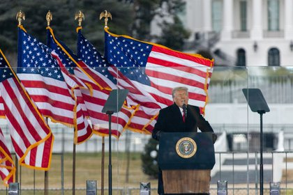 """U.S. President Donald Trump speaks during a """"Save America Rally"""" near the White House in Washington, D.C., U.S., on Wednesday, Jan. 6, 2021. Trump's months-long effort to toss out the election results and extend his presidency will meet its formal end this week, but not without exposing political rifts in the Republican Party that have pitted future contenders for the White House against one another."""