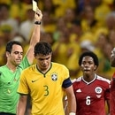 Brazil's defender and captain Thiago Sil...Brazil's defender and captain Thiago Silva (C) receives a yellow card from Spanish referee Carlos Velasco Carballo (2L) during the quarter-final football match between Brazil and Colombia at the Castelao Stadium in Fortaleza during the 2014 FIFA World Cup on July 4, 2014. AFP PHOTO / FABRICE COFFRINIFABRICE COFFRINI/AFP/Getty Images(AFP)