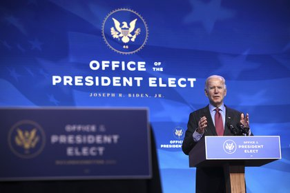 WILMINGTON, DELAWARE - JANUARY 08: U.S. President-elect Joe Biden delivers remarks after he announced cabinet nominees that will round out his economic team, including secretaries of commerce and labor, at The Queen theater on January 08, 2021 in Wilmington, Delaware. Biden announced he is nominating Rhode Island Gov. Gina Raimondo as his commerce secretary, Boston Mayor Martin J. Walsh his labor secretary and Isabel Guzman, a former Obama administration official, as head of the Small Business Administration. (Photo by Chip Somodevilla/Getty Images)