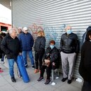 Retirees and people on welfare plans queue outside a bank, as it opened for first time since the mandatory quarantine due to the coronavirus disease (COVID-19), in Buenos Aires, Argentina April 3, 2020. REUTERS/Agustin Marcarian