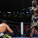 Deontay Wilder, left, knocks down Dominic Breazeale during the first round of a WBC heavyweight championship boxing match Saturday, May 18, 2019, in New York. Wilder stopped Breazeale in the first round.(AP Photo/Frank Franklin II)