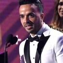 Luis Fonsi accepts the award for record of the year for