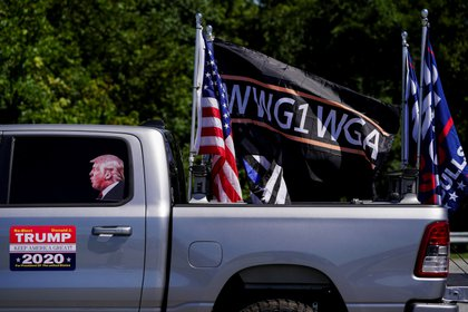 Pro-Trump flags and a flag reading WWG1WGA, a reference to the QAnon  slogan is seen on a truck that participated in a caravan convoy in Adairsville, Georgia, U.S. September 5, 2020.    REUTERS/Elijah Nouvelage