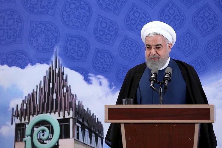 El presidente iraní, Hasan Rohaní (Photo by HO / Iranian Presidency / AFP)