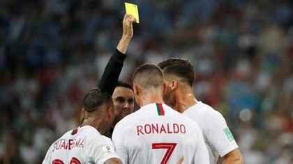 Soccer Football – World Cup – Round of 16 – Uruguay vs Portugal – Fisht Stadium, Sochi, Russia – June 30, 2018   Portugal's Cristiano Ronaldo is shown a yellow card by referee Cesar Arturo Ramos    REUTERS/Jorge Silva