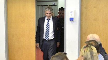 Sonrisa tensa: Russo entra a la sala del Juzgado Nº6 para recibir su condena (Foto: Gustavo Gavotti)