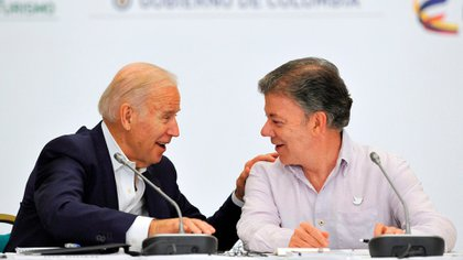 zzzzinte1US Vice-President Joe Biden (L) and Colombian President Juan Manuel Santos attend the US-Colombia Business Advisory Council Meeting opening session in Cartagena, Colombia, on December 2, 2016. / AFP PHOTO / GUILLERMO LEGARIAzzzz