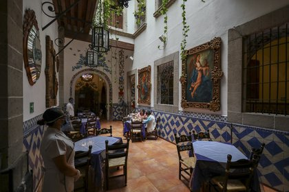 """Customers eat in Mexico City's iconic """"Cafe Tacuba"""" restaurant, while keeping their distance to help curb the spread of the new coronavirus, Wednesday, July 1, 2020. (AP Photo/Eduardo Verdugo)"""