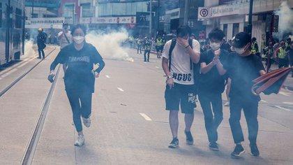 Las manifestaciones comenzaron hace nueve meses, primero contra la propuesta de una ley de extradición, luego por pedidos de democratización y de límite a la violencia policial y ahora contra ley de seguridad nacional que impulsa Beijing (Isaac Lawrence/ AFP)