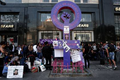 People gather in a memory of seven-year-old Fatima Cecilia Aldrighett, who went missing and whose body was discovered inside a plastic bag, at an anti-femicide monument, in Mexico City, Mexico February 19, 2020. REUTERS/Carlos Jasso