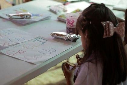 Les parents doivent terminer le processus étudiant.  (Photo: Reuters)