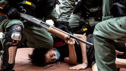 Represión Hong Kong. (Photo by ISAAC LAWRENCE / AFP)