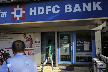 A man walks towards an HDFC Bank Ltd. branch in Mumbai, India, on Saturday, April 21, 2018. HDFC is scheduled to announce fourth-quarter earnings on April 30.