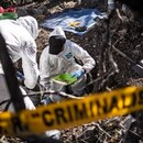 Forensic personnel of the Mexican Attorney General work in the exhumation of human remains found during the activities of the fourth National Search Brigade, in Huitzuco de los Figueroa, Guerrero state, Mexico, on January 21, 2019. - More than 40,000 people are missing in Mexico, which has been swept by a wave of violence since declaring war on its powerful drug cartels in 2006. But there is even a more tragic group: some 20 families who have lost children not once but twice, when the ones who remained went looking for their missing siblings and ended up disappearing too. (Photo by Pedro PARDO / AFP)