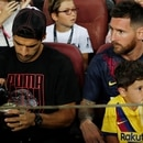 Soccer Football - La Liga Santander - FC Barcelona v Real Betis - Camp Nou, Barcelona, Spain - August 25, 2019 Barcelona's Luis Suarez and Lionel Messi watch the match from the stands REUTERS/Albert Gea