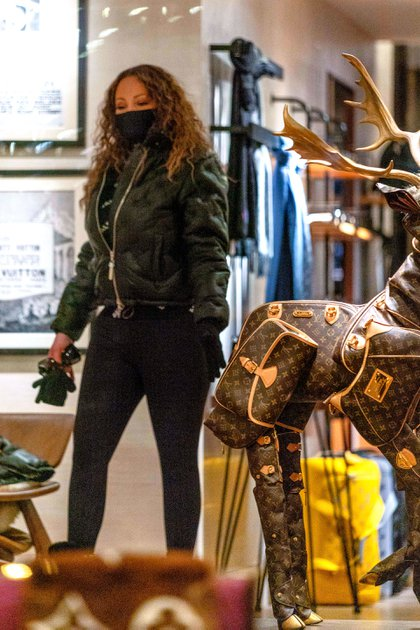 Shopping.  Mariah Carey visited the upscale Louis Vuitton location during her vacation in Aspen, Colorado, where she vacationed to ski the best slopes in the country.  The singer toured the store with her daughter Monroe Cannon