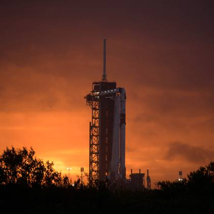The sun sets behind a SpaceX Falcon 9 rocket with the company's Crew Dragon spacecraft onboard on the launch pad of Launch Complex 39A as preparations continue for the NASA's SpaceX Demo-2 mission to the International Space Station at NASA's Kennedy Space Center in Cape Canaveral in Florida May 25, 2020. Picture taken May 25, 2020. NASA/Bill Ingalls/Handout via REUTERS.  THIS IMAGE HAS BEEN SUPPLIED BY A THIRD PARTY. MANDATORY CREDIT