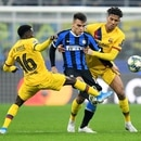 Soccer Football - Champions League - Group F - Inter Milan v FC Barcelona - San Siro, Milan, Italy - December 10, 2019 Inter Milan's Lautaro Martinez in action with Barcelona's Jean-Clair Todibo and Moussa Wague REUTERS/Daniele Mascolo