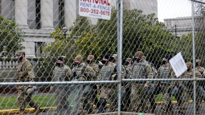 A unit of Washington National Guard move outside the Washington State Capitol in anticipation of potential armed protests in Olympia, U.S. January 17, 2021. REUTERS/Lindsey Wasson