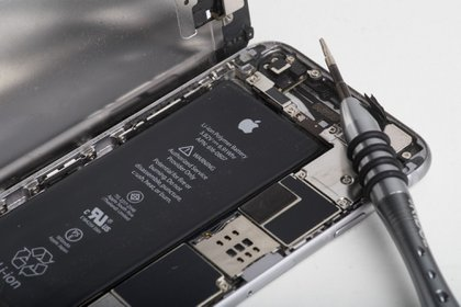 A lithium-ion battery is seen inside the rear case of an Apple Inc. iPhone 6 smartphone in an arranged photograph in Bangkok, Thailand, on Friday, Feb. 2, 2018. Apple Chief Executive Officer Tim Cook told shareholders on Feb. 13 at the company's annual meeting to expect higher dividends and stressed that succession planning is a priority.