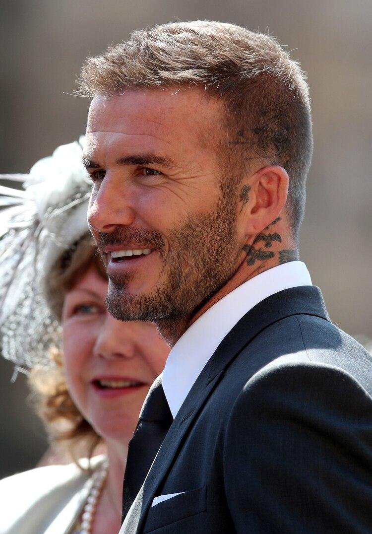 David Beckham y sus tatuajes en cuello y cabeza (AFP)