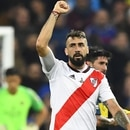 River Plate's Lucas Pratto celebrates after scoring against Boca Juniors during the second leg match of the all-Argentine Copa Libertadores final, at the Santiago Bernabeu stadium in Madrid, on December 9, 2018. (Photo by Gabriel BOUYS / AFP)