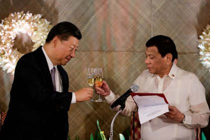 Xi Jinping and Rodrigo Duterte (Reuters)