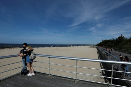 Beachgoers along the boardwalk at Sunken Meadow State Park in Kings Park, Long Island, New York, USA, 24 May 2020. EFE/EPA/Peter Foley