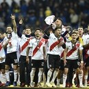 Players of River Plate celebrate after winning the second leg match of the all-Argentine Copa Libertadores final against Boca Juniors, at the Santiago Bernabeu stadium in Madrid, on December 9, 2018. - River Plate came from behind to beat bitter Argentine rivals Boca Juniors 3-1 in extra time. (Photo by OSCAR DEL POZO / AFP)