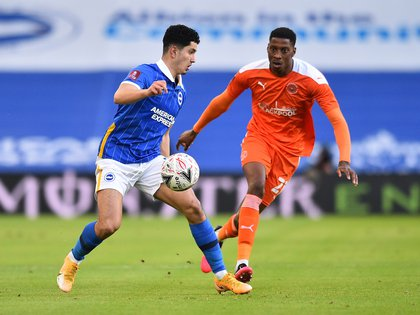 Soccer Football - FA Cup - Fourth Round - Brighton & Hove Albion v Blackpool - The American Express Community Stadium, Brighton, Britain - January 23, 2021 Brighton & Hove Albion's Steven Alzate in action with Blackpool's Marvin Ekpiteta Pool via REUTERS/Glyn Kirk