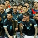 Soccer Football - International Friendly - Brazil v Argentina - King Saud University Stadium, Riyadh, Saudi Arabia - November 15, 2019 Argentina's Lionel Messi with a trophy and teammates as they celebrate after the match REUTERS/Ahmed Yosri
