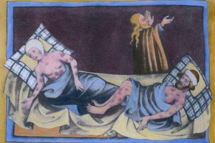 Un hombre y una mujer con la peste bubónica con las características úlceras en sus cuerpos en una pintura medieval de una Biblia de 1411 en Toggenburg, Suiza (Foto: Shutterstock)