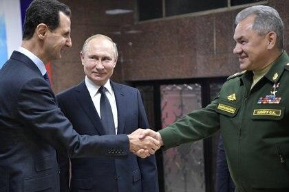 El presidente ruso, Vladimir Putin, el ministro de Defensa ruso, Sergei Shoigu, y el presidente sirio, Bashar al-Assad, durante una reunión en Damasco, el 7 de enero de 2020. (Sputnik / Aleksey Nikolskyi / Kremlin)