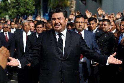 Seguidores de la iglesia de la Luz del Mundo siguen creyendo que Naasón García es inocente (Foto: AFP)
